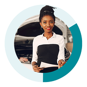 young african american lady in the car service drive